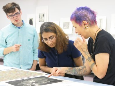 Texas Tech University School of Art professor Stacy Elko explaining an aquatint to two students in the AP/RC