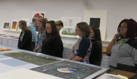West Texas A&M professor Scott Frish (blue shirt) with his advanced printmaking class in the AP/RC